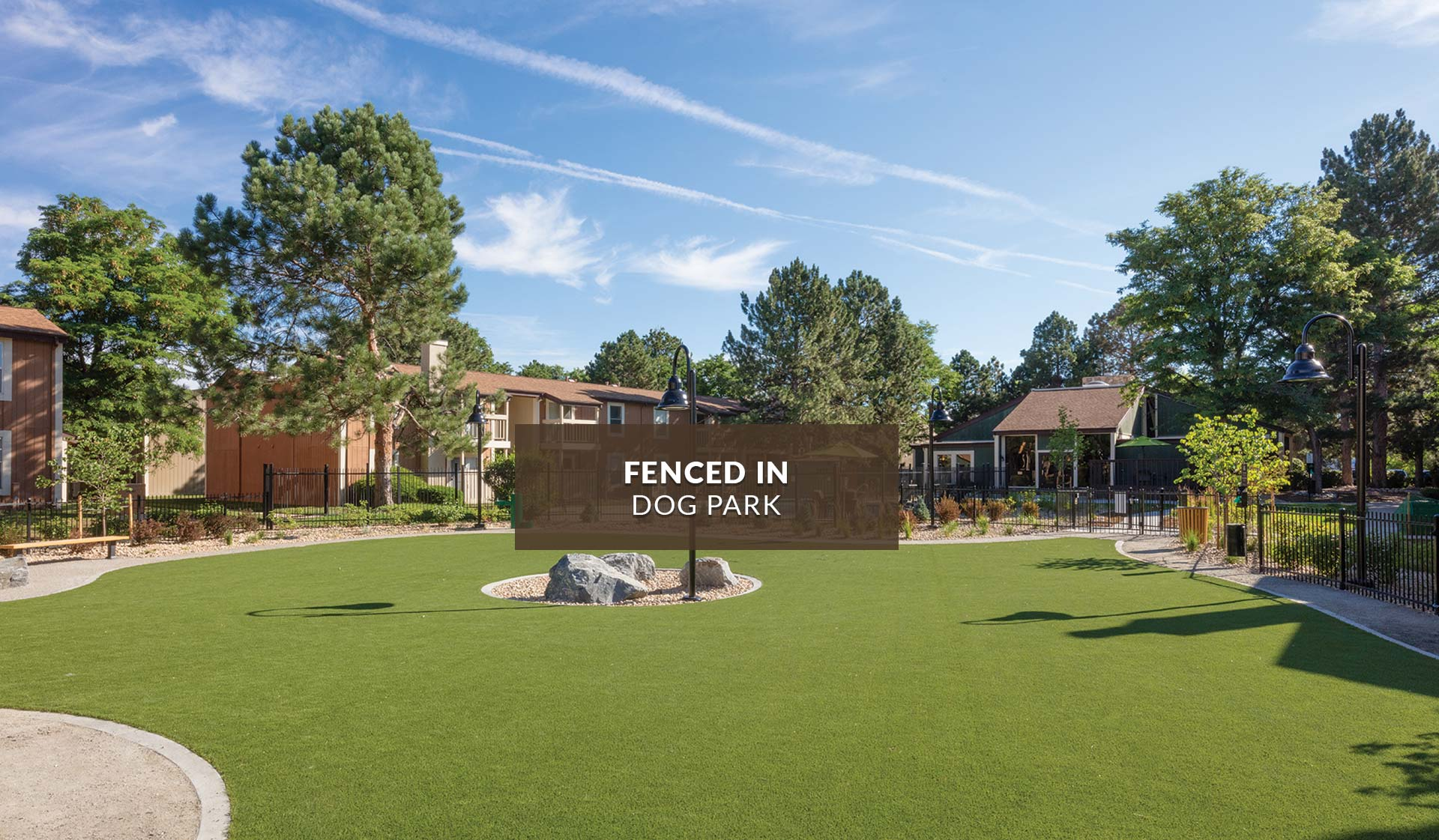 Creekside Apartments - dog park with apartment buildings in background - denver, CO