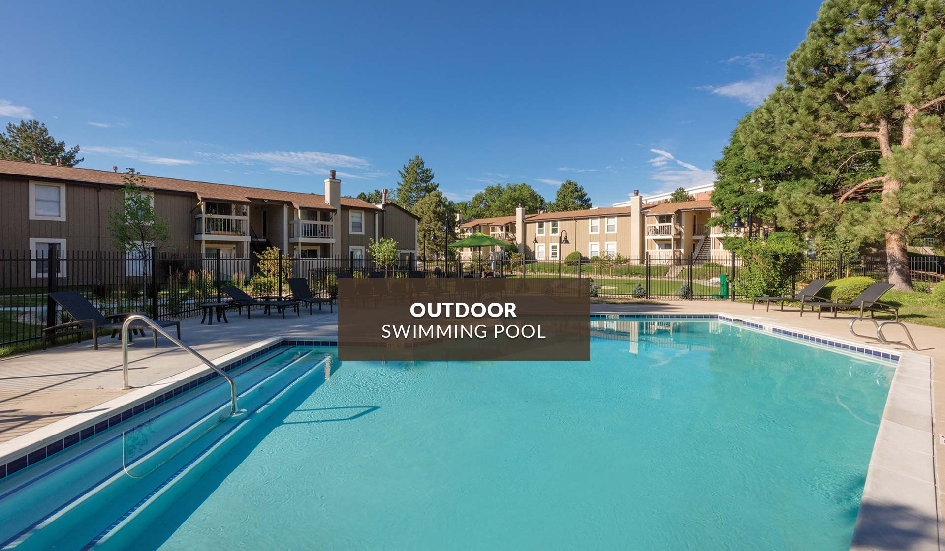 Creekside Apartments - outdoor swimming pool with apartment buildings in background - denver, CO