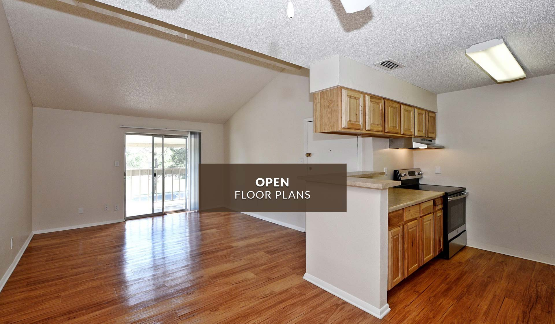 Creekside Apartments - interior of open floor plan with living room and kitchen - denver, CO