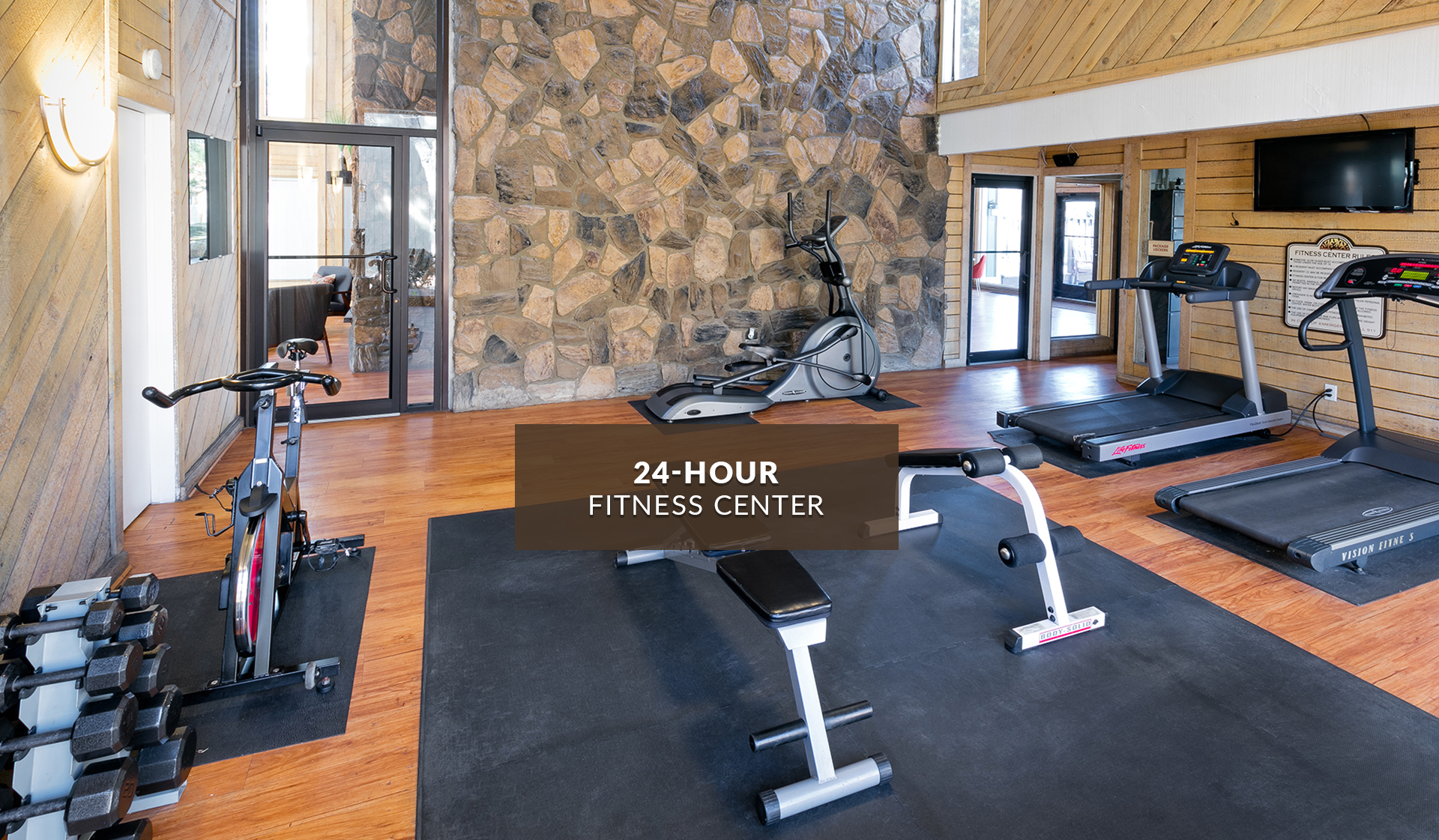 Creekside Apartments - fitness center with treadmills, bike, and weight lifting equipment - denver, CO